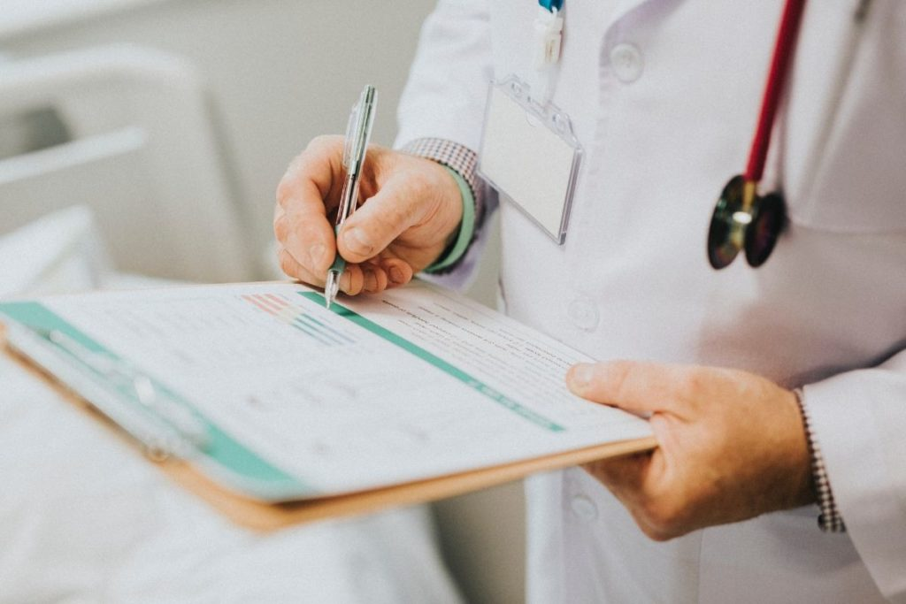 Doctor writing on a paper